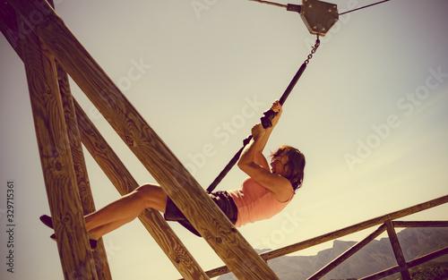 Adult woman having fun on zipline Canvas Print
