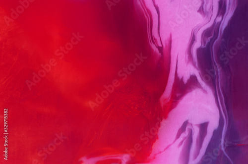 Red and pink translucent  multicolored abstract background with paint stains - 329715382