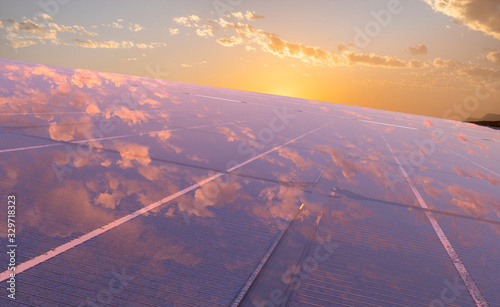 Fotografía clean energy concept, photovoltaic panels in the light of the rising sun