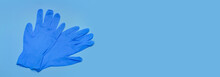 Pair Of Blue Medical Gloves On...