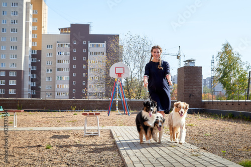 Pretty funny girl with nice dog at children playground in the yard of city in a Tapéta, Fotótapéta