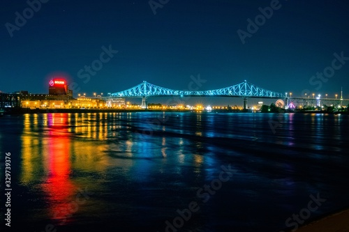 Montreal's Jacques Cartier Bridge illuminated with blue lights at night