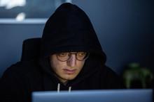 Close-up Of Hacker Penetrating...