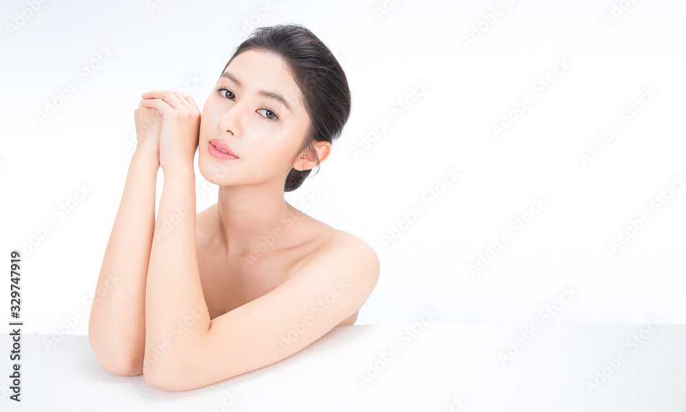 Fototapeta Closeup portrait of beauty asian woman fair perfect healthy glow skin hand touch shoulder copy space, young beautiful asia girl with pretty smile on face. Beauty korean clinic skincare concept banner