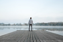 Young Man Standing Alone On Wo...