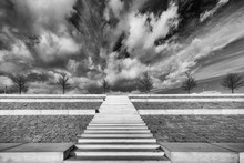 Low Angle Greyscale Shot Of A Staircase Under The Cloudy Sky In Nijmegen, The Netherlands