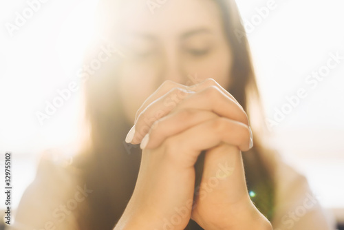 Cute beautiful girl folded her hands in prayer Canvas Print