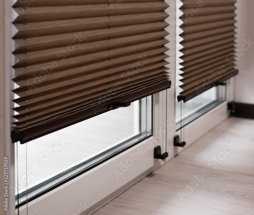 Valokuva Pleated blinds Cosiflor close up on the window in the interior