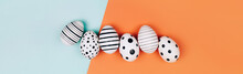 Banner Made With Easter Eggs Dotted On Multicolored Background. Festive Concept. Flat Lay Style
