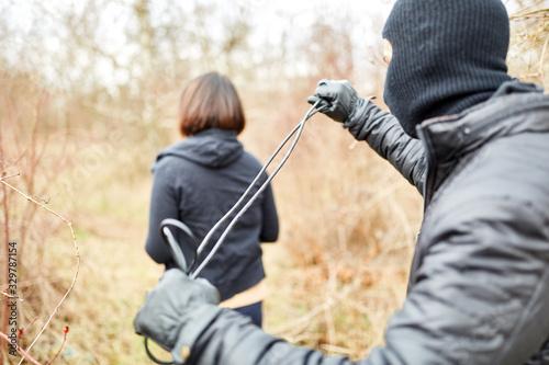 Photo Vermummter Verbrecher überfällt Joggerin