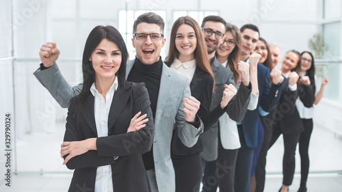 Fototapeta happy group of diverse young people standing in a row obraz