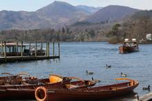 Motor Launch With Derwent Isle In Background. Cumbria Britain,UK