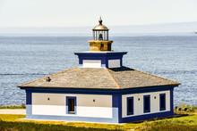 Lighthouse On The Coast Of Sea...