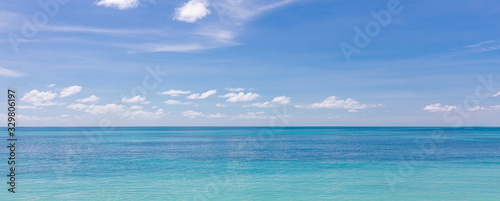 Relaxing seascape with wide horizon of the sky and the sea. Calm ocean water