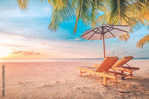 Beautiful tropical sunset scenery, two sun beds, loungers, umbrella under palm tree Slika na platnu