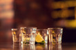 alcohol shots on wooden table