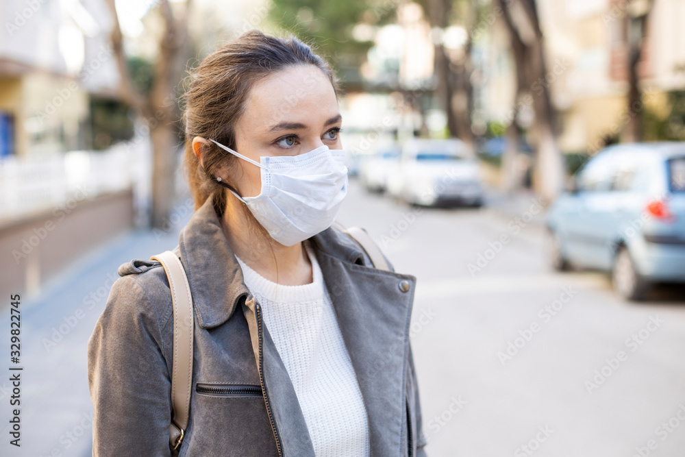 Fototapeta Young woman in medical face protection mask