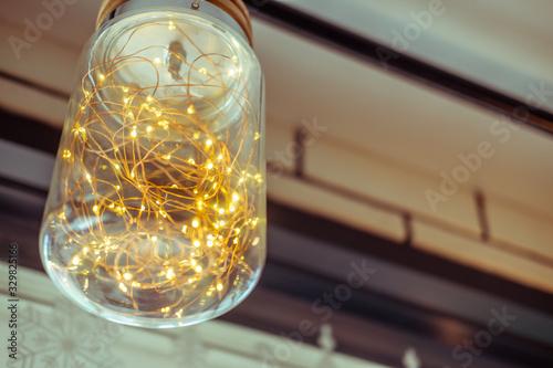 Ceiling lamp inside with orange blinker light bulbs Wallpaper Mural