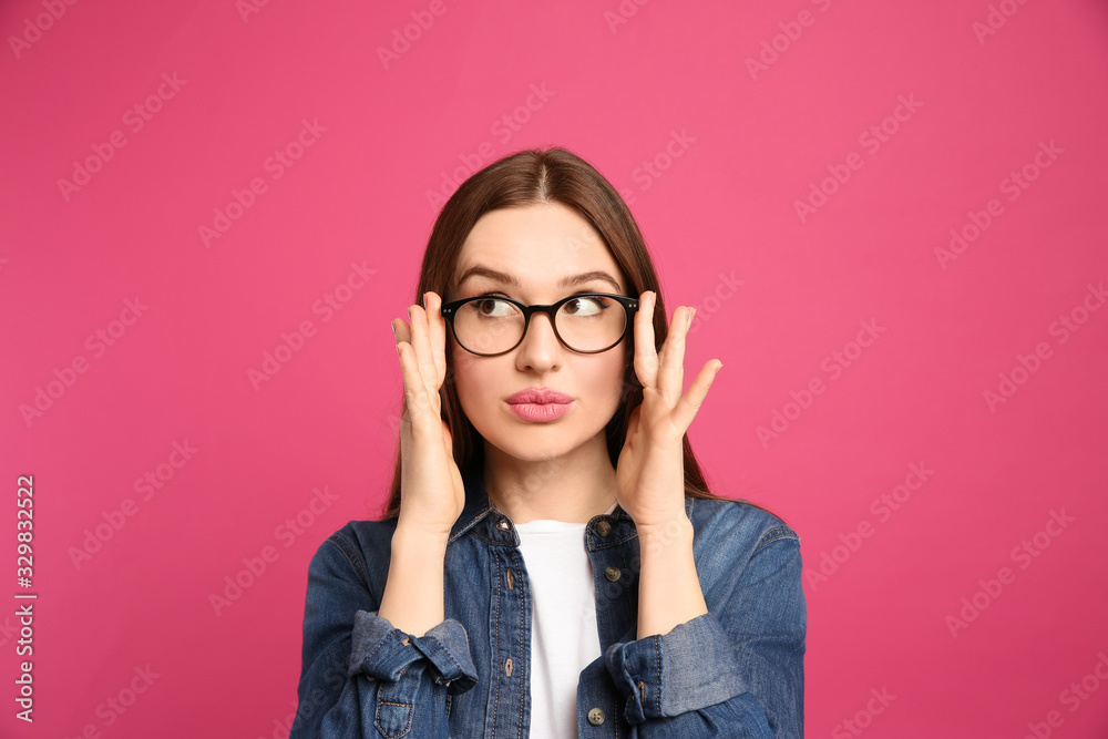 Fototapeta Pensive woman on pink background. Thinking about answer for question
