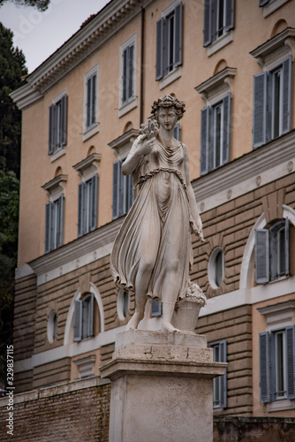 Allegorical statue in summer, Piazza del Popolo in Rome, Italy. Wallpaper Mural
