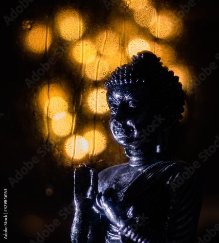 Fototapeta bhudda with rain water drops on glass window obraz na płótnie