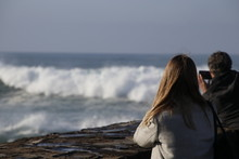 Couple Staring At The Waves