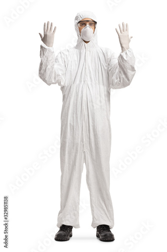 Man wearing a white protective suit and gloves Wall mural