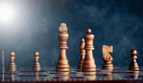 Fotografija Powerful king and queen pieces on chess board battlefield
