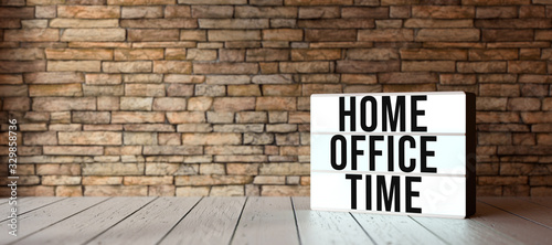lightbox with text HOME OFFICE TIME in front of a brick wall