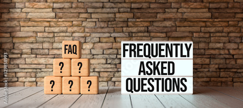 Photo cubes with the abbreviation FAQ and lightbox with message FREQUENTLY ASKED QUEST