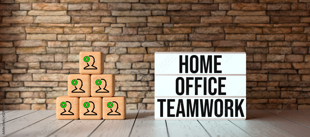 Fototapeta cubes with person-symbols stacked as a pyramid and lightbox with text HOME OFFICE TEAMWORK in front of a brick wall
