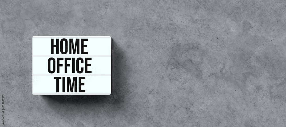 Fototapeta lightbox with text HOME OFFICE TIME in front concrete wall