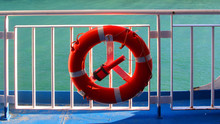 Water Wheely A Life Saving Buoy On Guard Railing Of A Cruise Ship