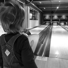 Rear View Of Boy Looking At Bowling Alley