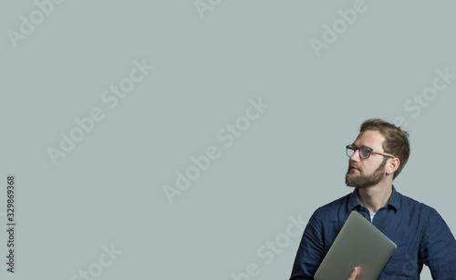 Fototapeta Man With Laptop Over Gray Background obraz