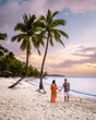 canvas print picture - Saint Lucia Caribbean Island, couple on luxury vatation at the tropical Island of Saint Lucia, men and woman by the beach and crystal clear ocean of St Lucia Caribbean Holliday