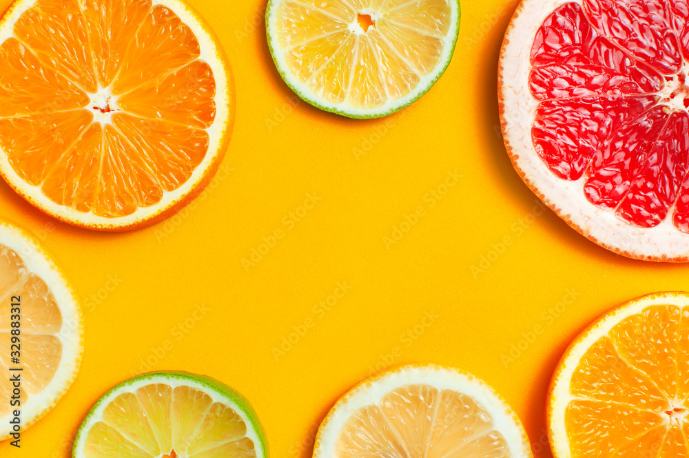 Fototapeta Flat lay composition with slices of fresh lemon orange grapefruit lime on yellow background top view copy space. Citrus Juice Concept, Vitamin C, Fruits. Creative summer background