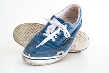 Pair Or Very Badly Worn Out Dirty Blue Casual Leisure Shoes With Holes In Them