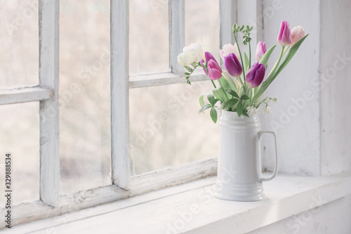 Obraz beautiful tulips on old white windowsill - fototapety do salonu
