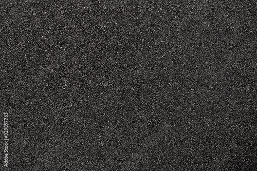 Granular abstract uniform grainy surface. Rough texture background.