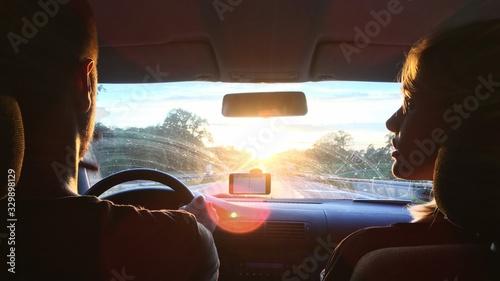 Fotografering Woman Looking At Man Driving Car