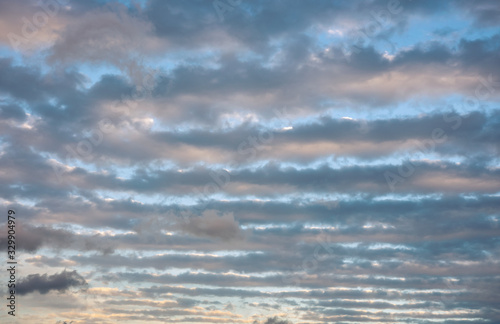 Rolls of cigar shaped clouds in the sky Canvas Print