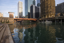 A View Along The Chicago River With Dearborn Street Bridge And Surrounding Iconic Architecture