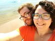 High Angle Portrait Of Couple At Beach On Sunny Day