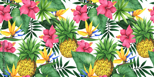 Foto Seamless floral pattern with pineapples, tropical flowers and leaves