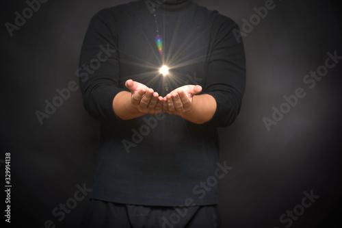 Obraz meditation hand with holy spiritual light, power of meditation, praying hand with bokeh light flare effect.  - fototapety do salonu