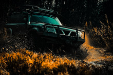 Safari Suv. Mud And Water Splash In Off The Road Racing. Off-road Travel On Mountain Road. 4x4 Travel Trekking. Rally Racing. Off Road Sport Truck Between Mountains Landscape.