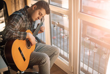 Portrait Of Man With Guitar In...