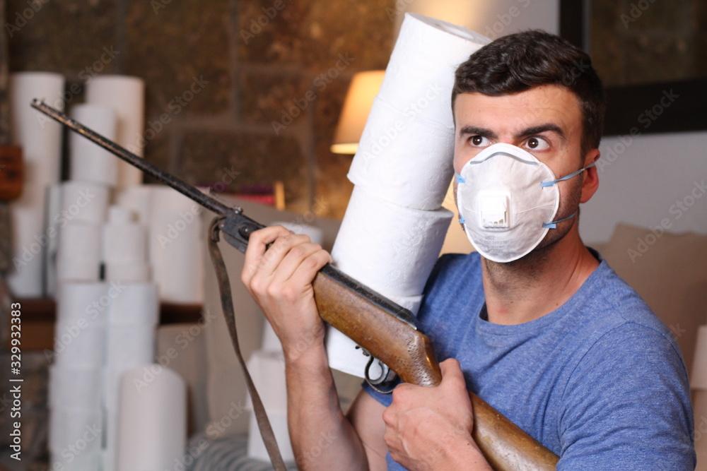 Fototapeta Greedy man stocking up toilet paper at home