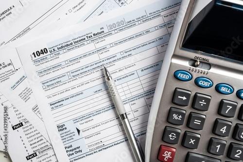 Fototapeta United States tax forms with calculator  obraz